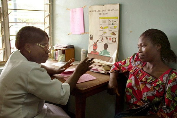 A nurse speaks to a woman about family planning at a health clinic in Jos, Niger