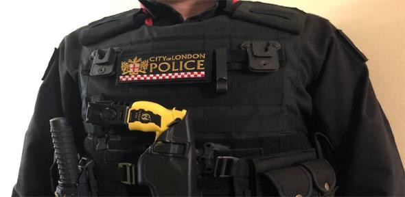 A City of London police officer armed with a Taser                   Credit: Cit