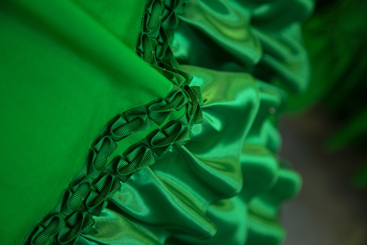 Close-up detail of the more than 200 feet of fabric ruffles and custom ribbon tr