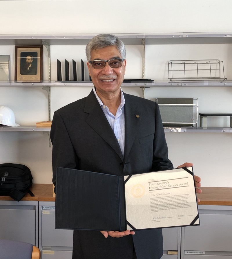Zahid Hussain holds his DOE Secretary's Distinguished Service Award certif