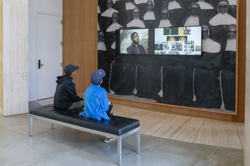 Visitors at Stanford's Cantor Arts Center absorb the video images from Kah