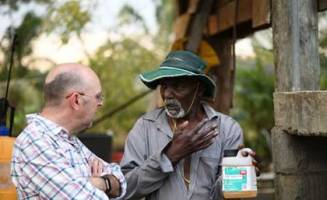 Photo: Michael Furlong. Talking with a farmer in Fiji about the problems associa
