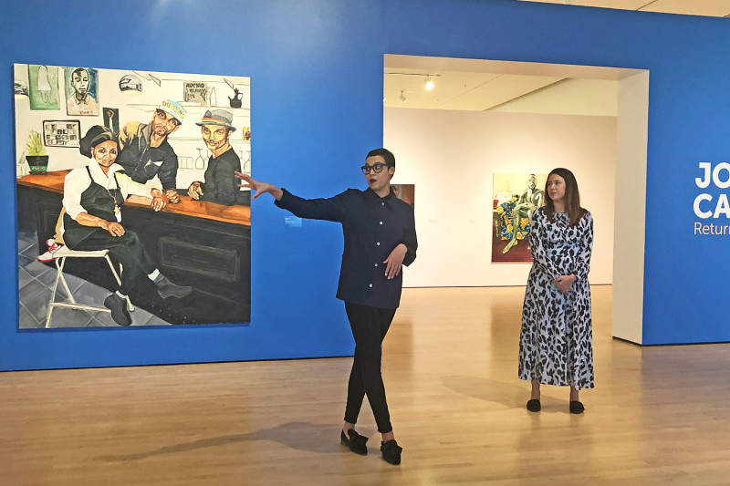 Artist Jordan Casteel gestures to her painting  Benyam  (2018) on view at the Ca
