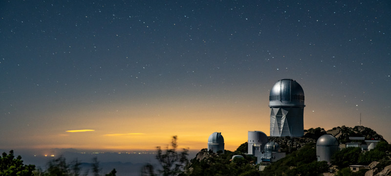 A view of the Mayall Telescope (tallest structure) and the Kitt Peak National Ob