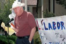 Political science John Manley recounts the history of labor unions at a May Day