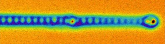 Atomic force microscopy image of the end of a mono-atomic iron wire. The indivi