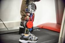 A student tests the robotic leg at the University of Texas at Dallas. The strong