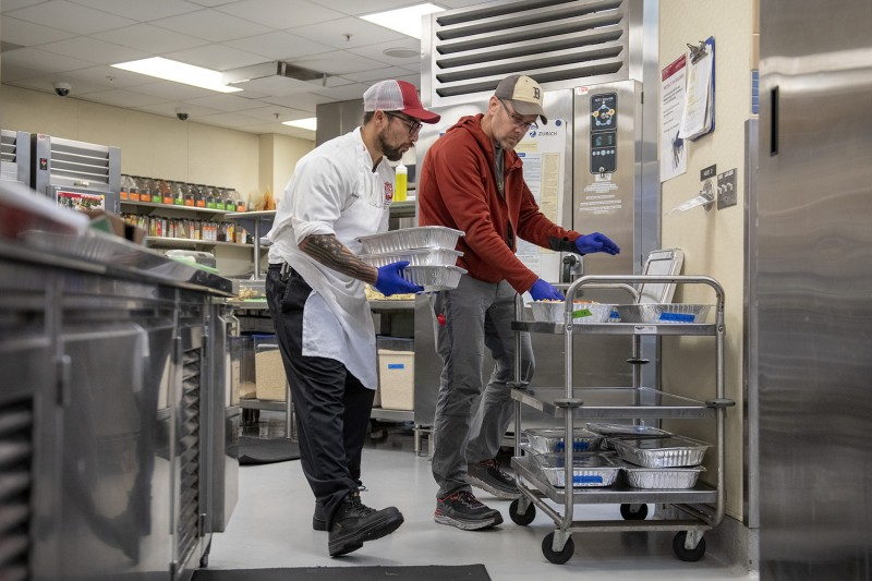 Stanford storekeeper Pedro Zandoval helps David Hott of the Silicon Valley Food