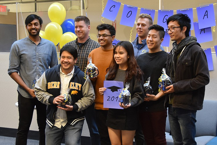 Eight of the nine data science majors who will graduate on Saturday gathered in