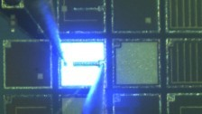 An LED emitting light on a 6-inch silicon wafer. Credit: Colin Humphreys.