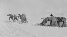 Foundering in soft snow: Bowers' sledge team; Wilson pushing; Oates and PO